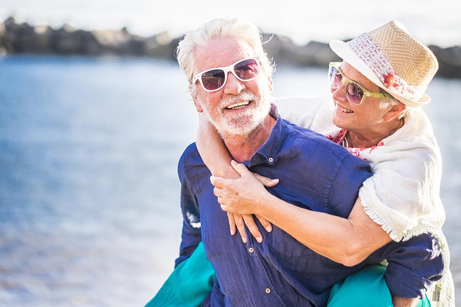 Micco, FL - Happy Senior Couple Having Fun and Enjoying Outdoors at the Beach