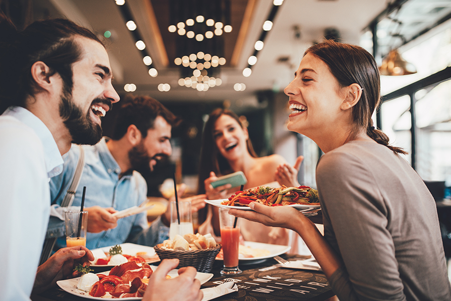 Specialized Business Insurance - Group of Happy Friends Having Breakfast in a Restaurant