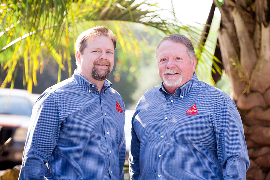 Contact - Paul Schneider and Father in Gainsville, Florida Office Standing in Front of Palm Trees